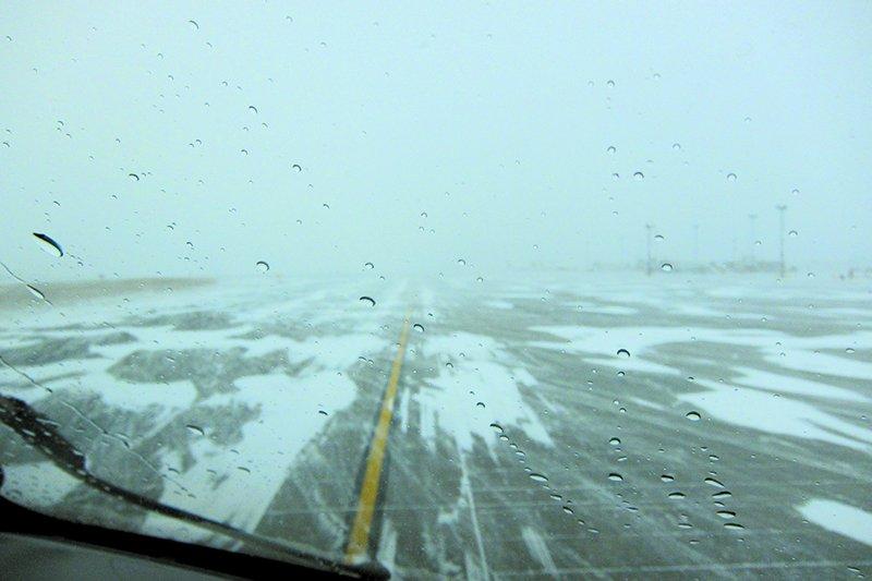 blowing snow on runway